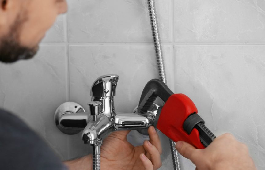 How To Fix Dripping Faucets Plumber Repairing Faucet In Shower Closeup